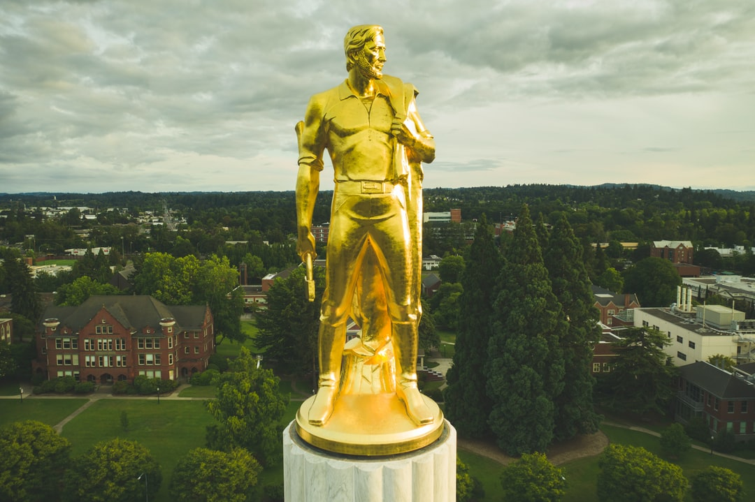 """Here's the first of two photos I'm uploading of """"the gold pioneer"""" on top of Oregon's capitol building in downtown Salem. I tried this on a sunny day once and the only way to cut down on the glow was to use a heavy ND/PL filter that just didn't look good on the background. The gray cloudy skies are more of Oregon's style. In the background is Willamette University."""