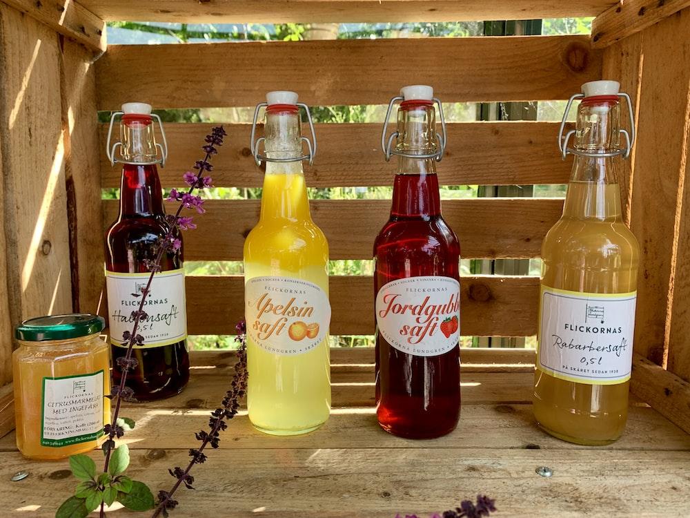 four assorted-color liquor bottles