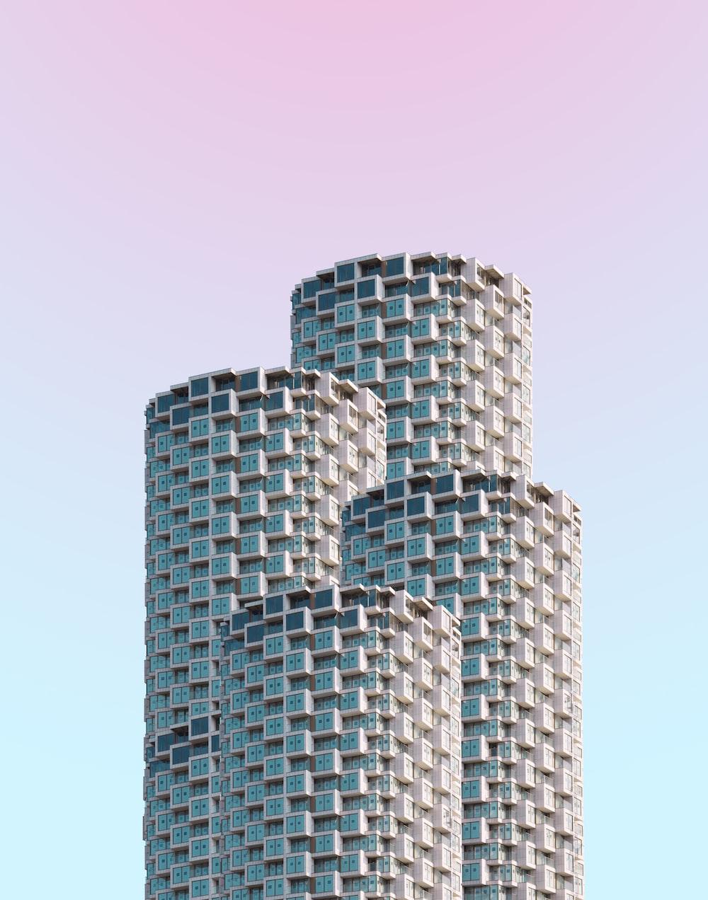 gray concrete building under clear blue sky