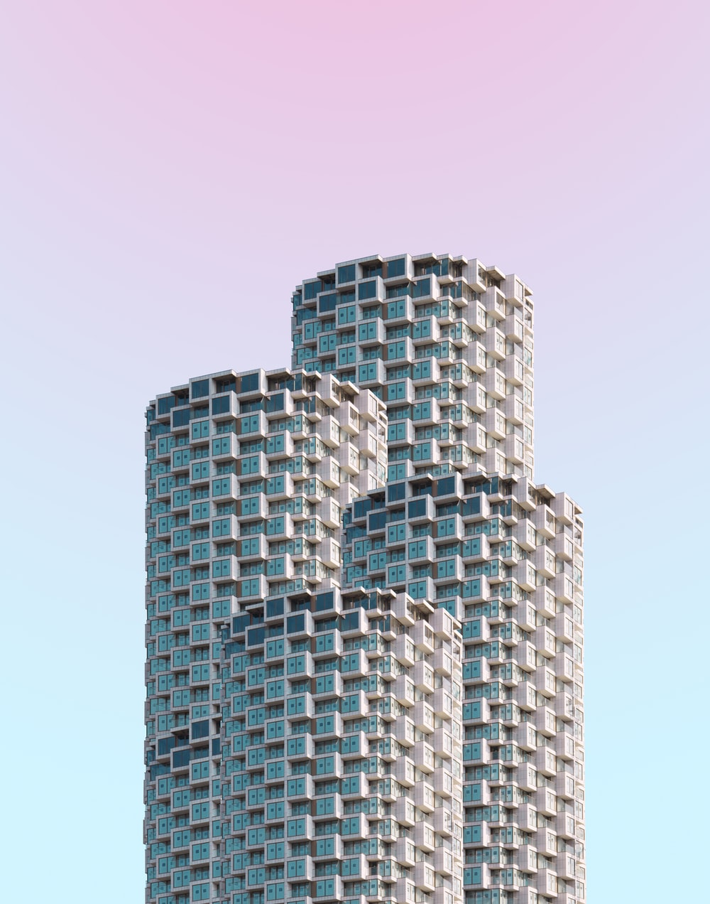 gray concrete building under clear blue sky