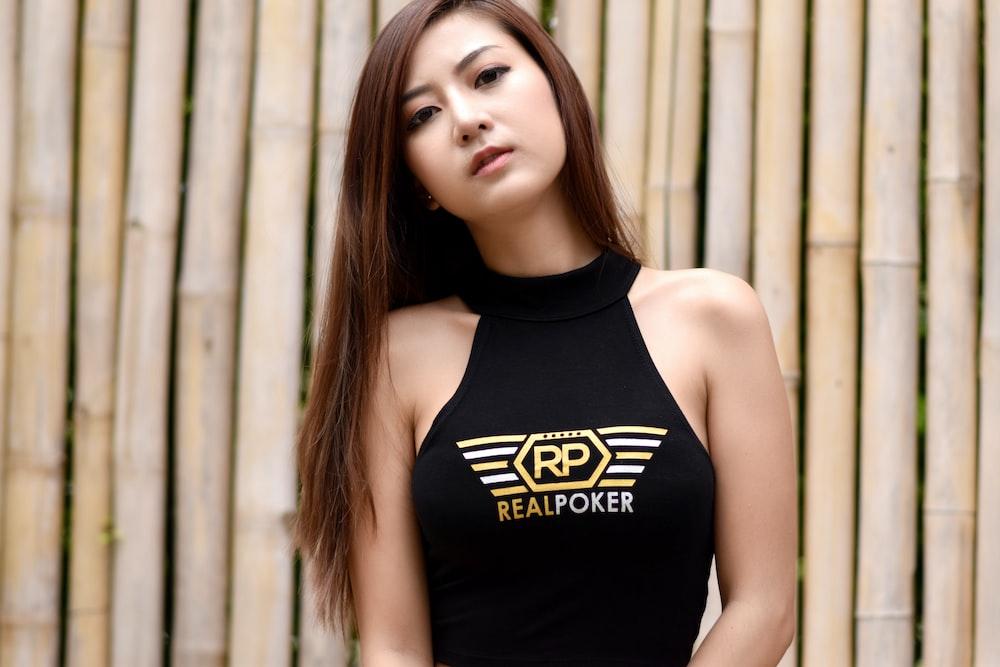 woman wearing black Real Poker-printed halter top