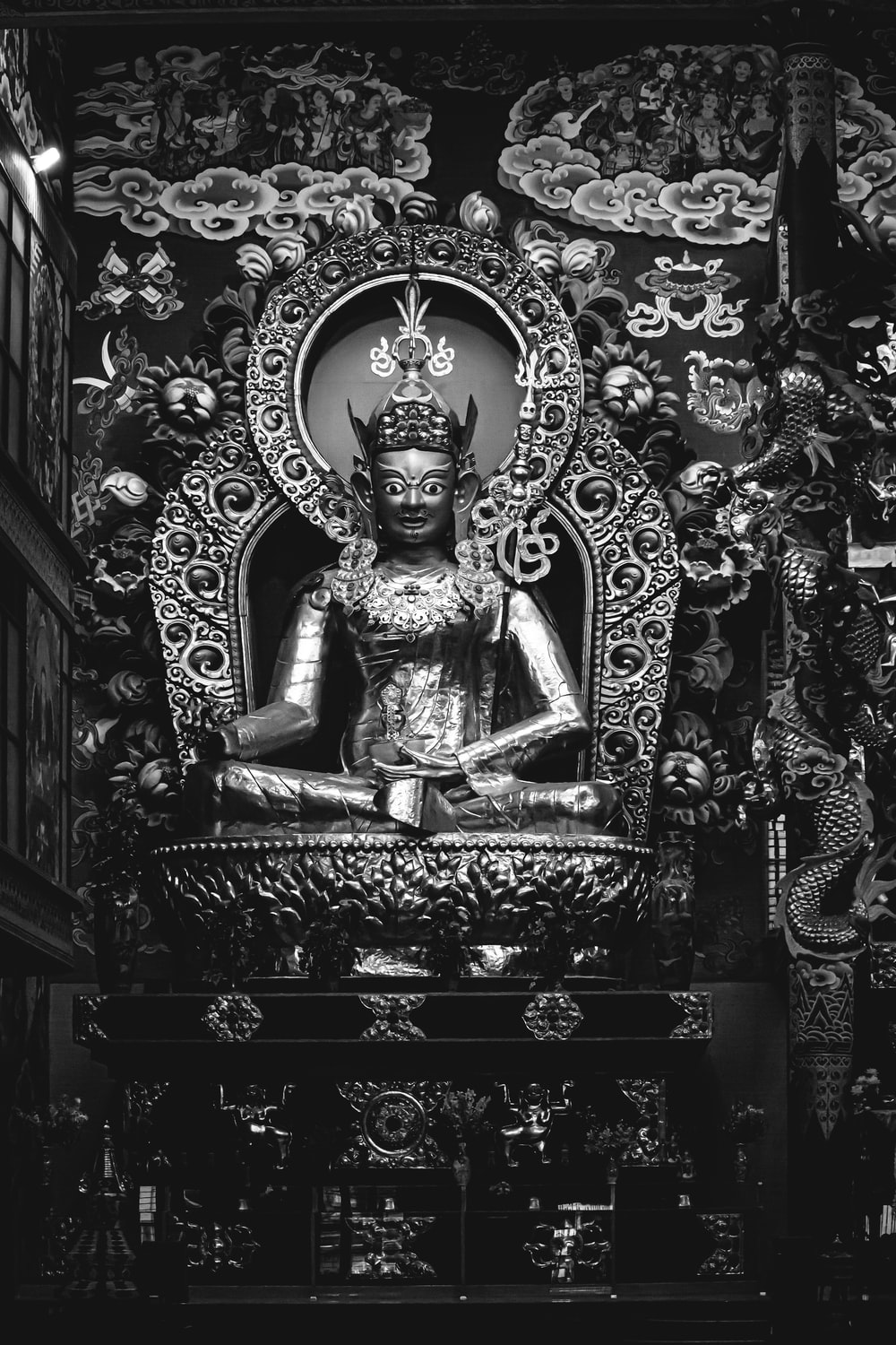 grayscale photo of Hindu god statue