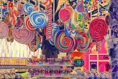 multicolored lollipops candy teams background