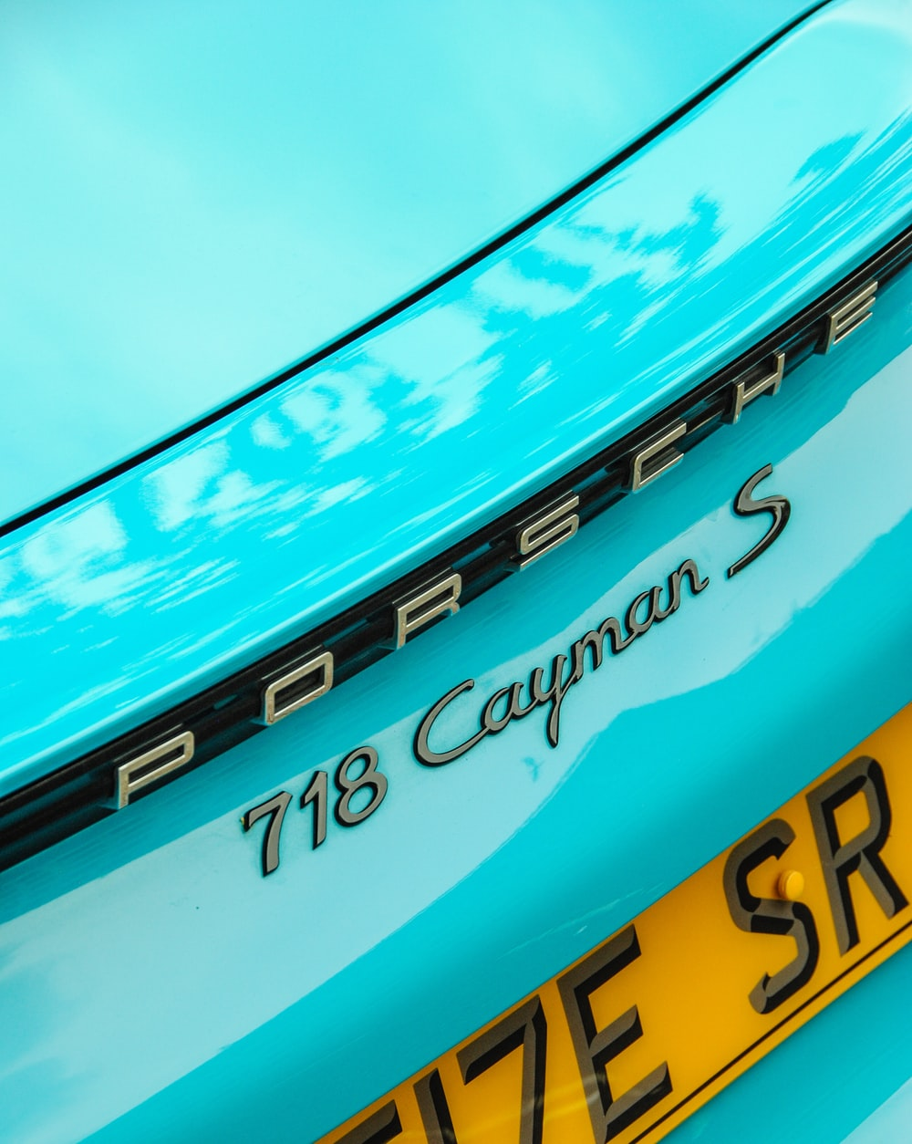 teal Porsche Cayman 718 S