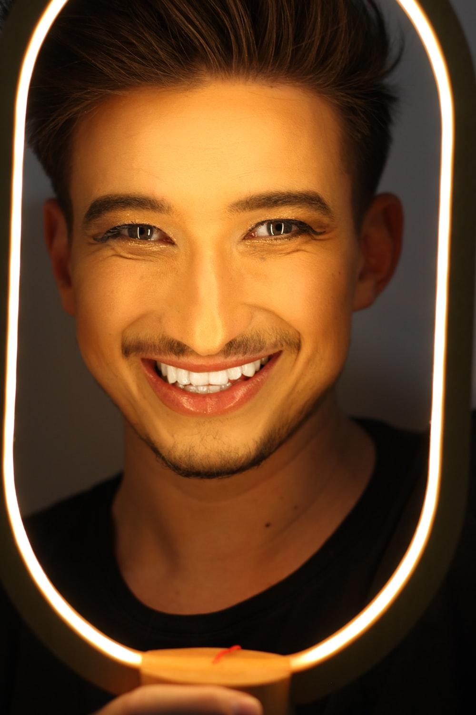 man smiling wearing black shirt