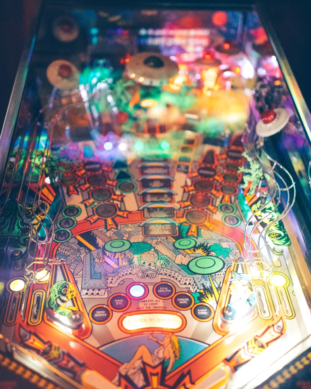 blue and multicolored pinball machine close-up photography