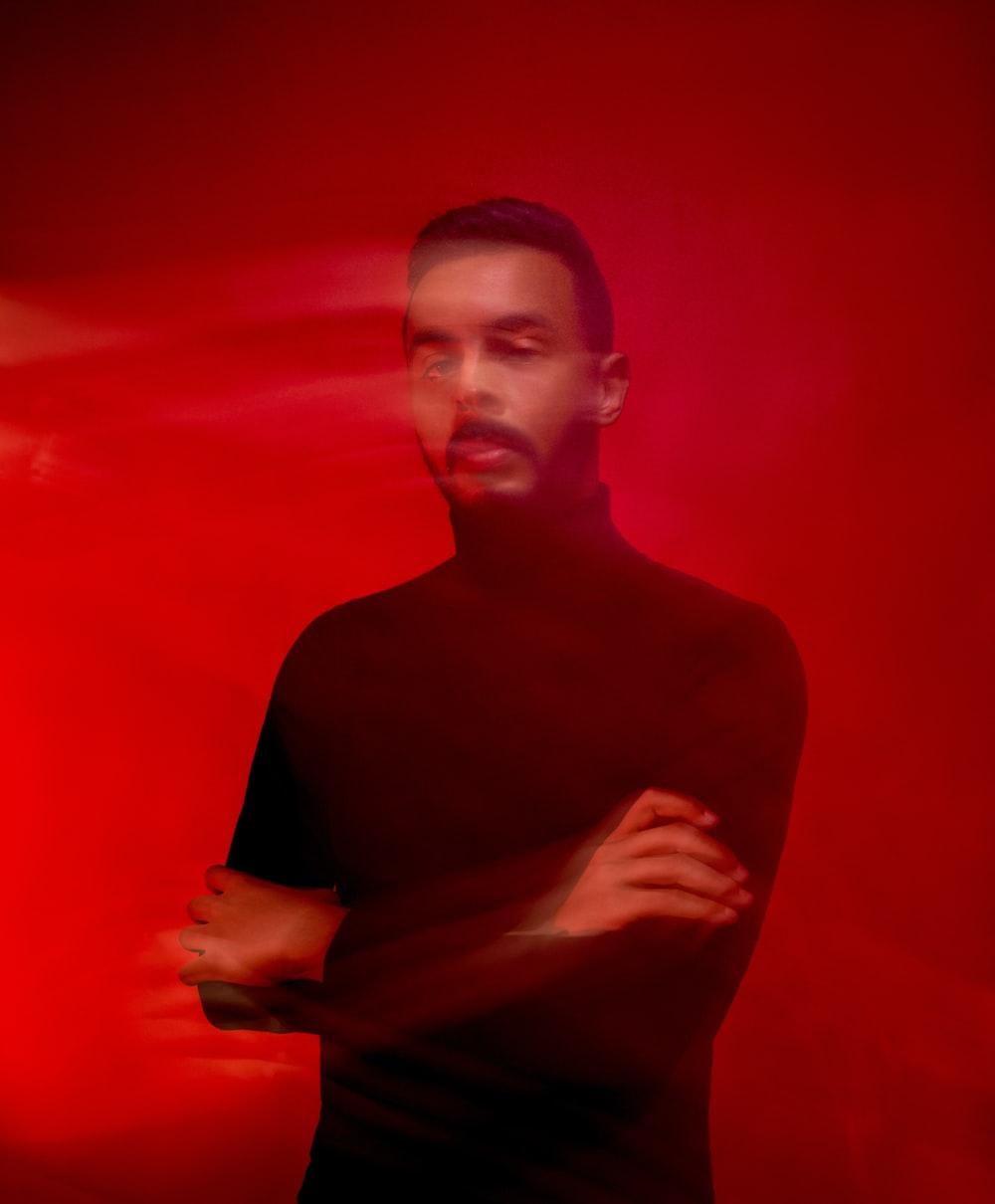 man wearing black turtleneck shirt standing