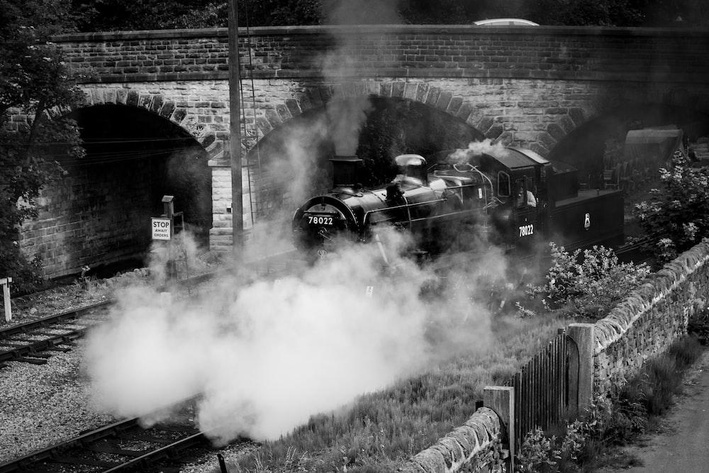 train on railway grayscale photography