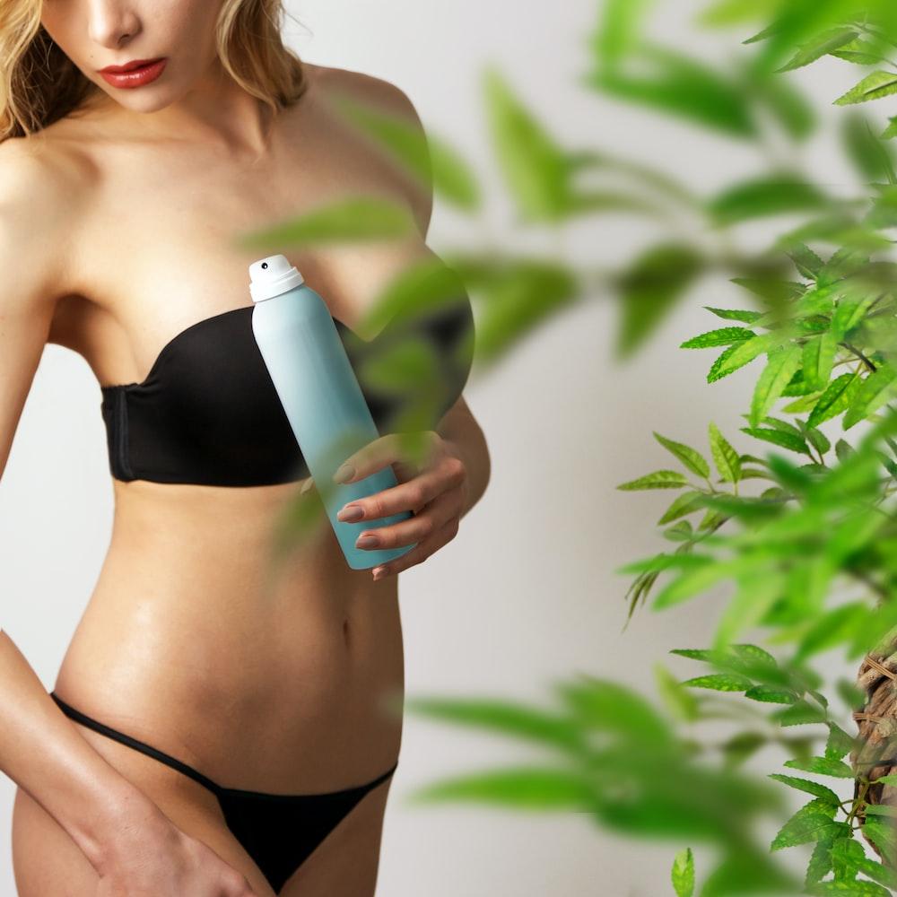 woman holding spray
