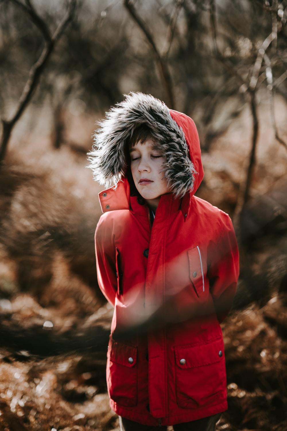 man wearing red coat