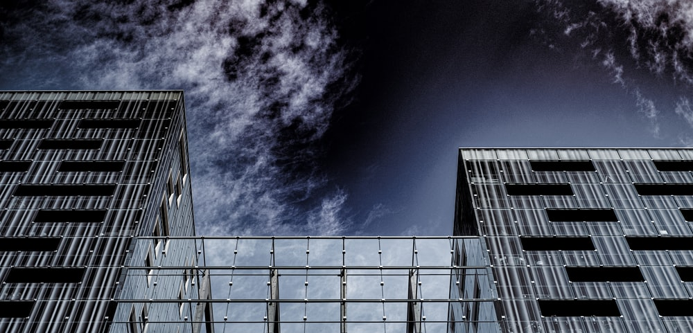worm view photo of building under cloudy sky during daytime