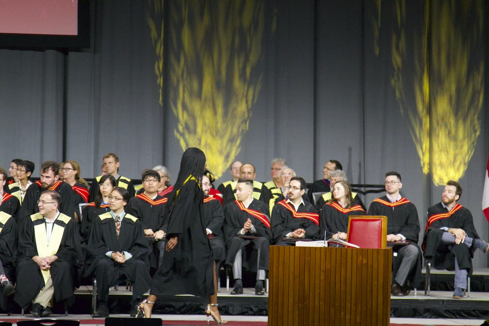 graduate walking on stage