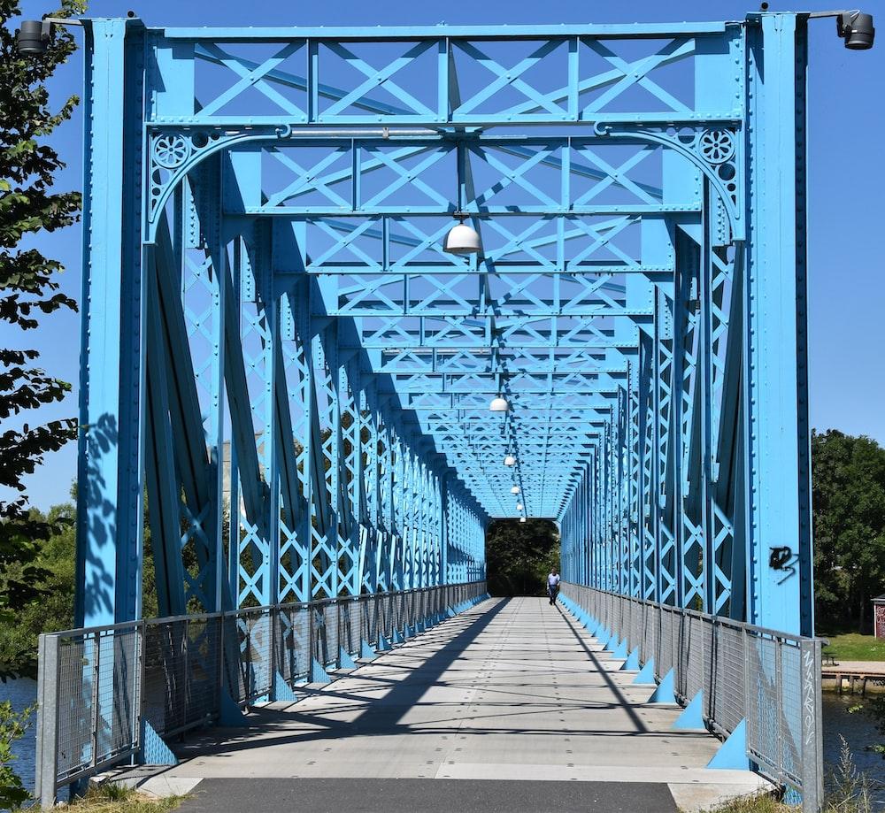 grey and blue metal bridge during daytime