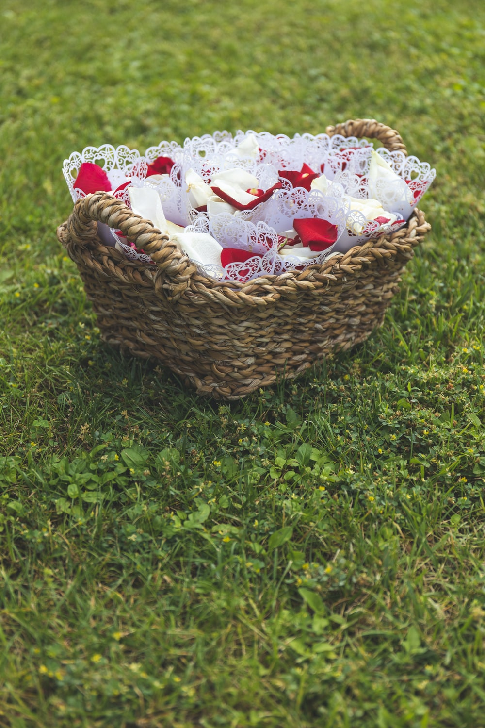 white-and-red party favors on brown wicket basket