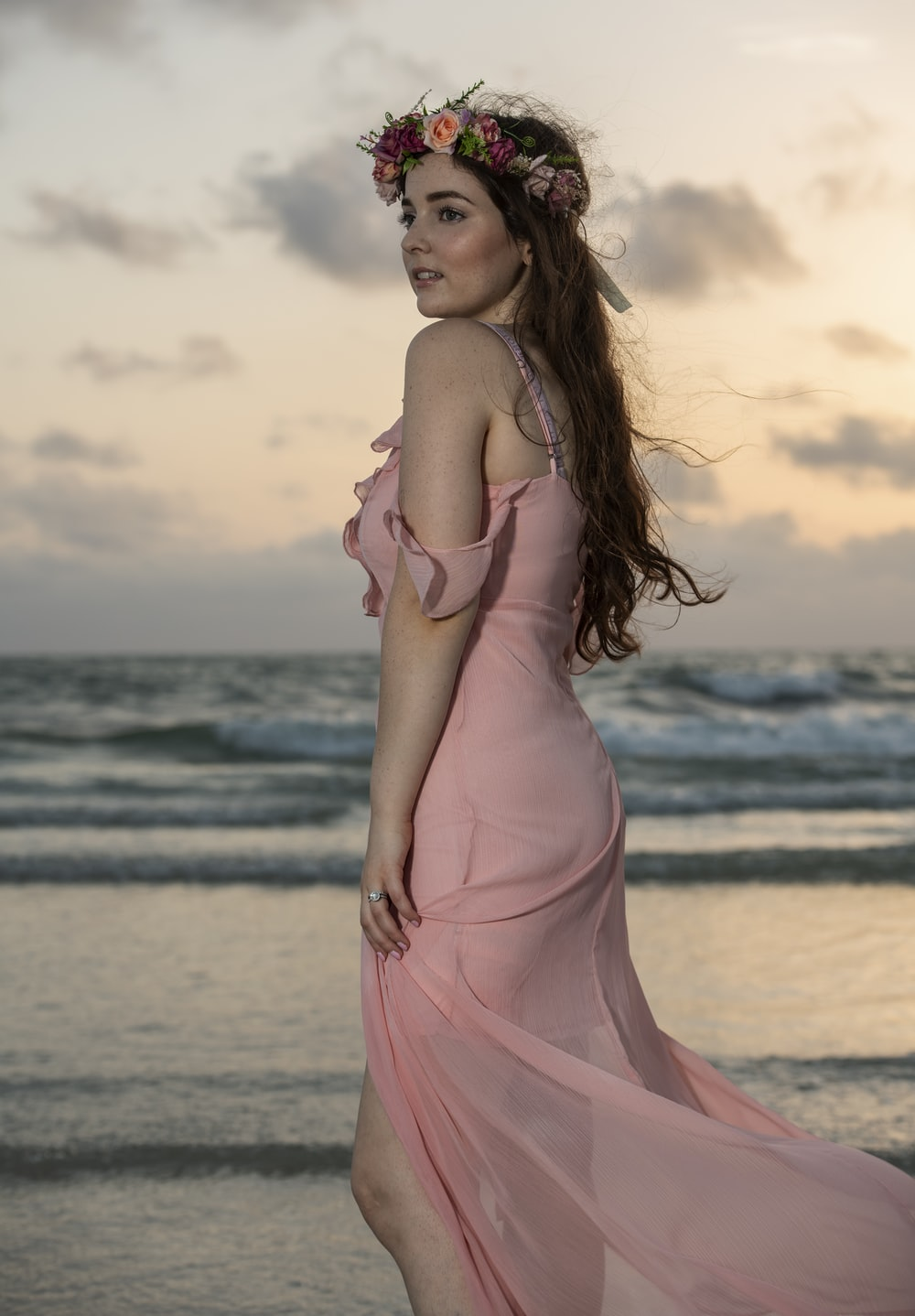 woman in peach cold-shoulder tulle gown