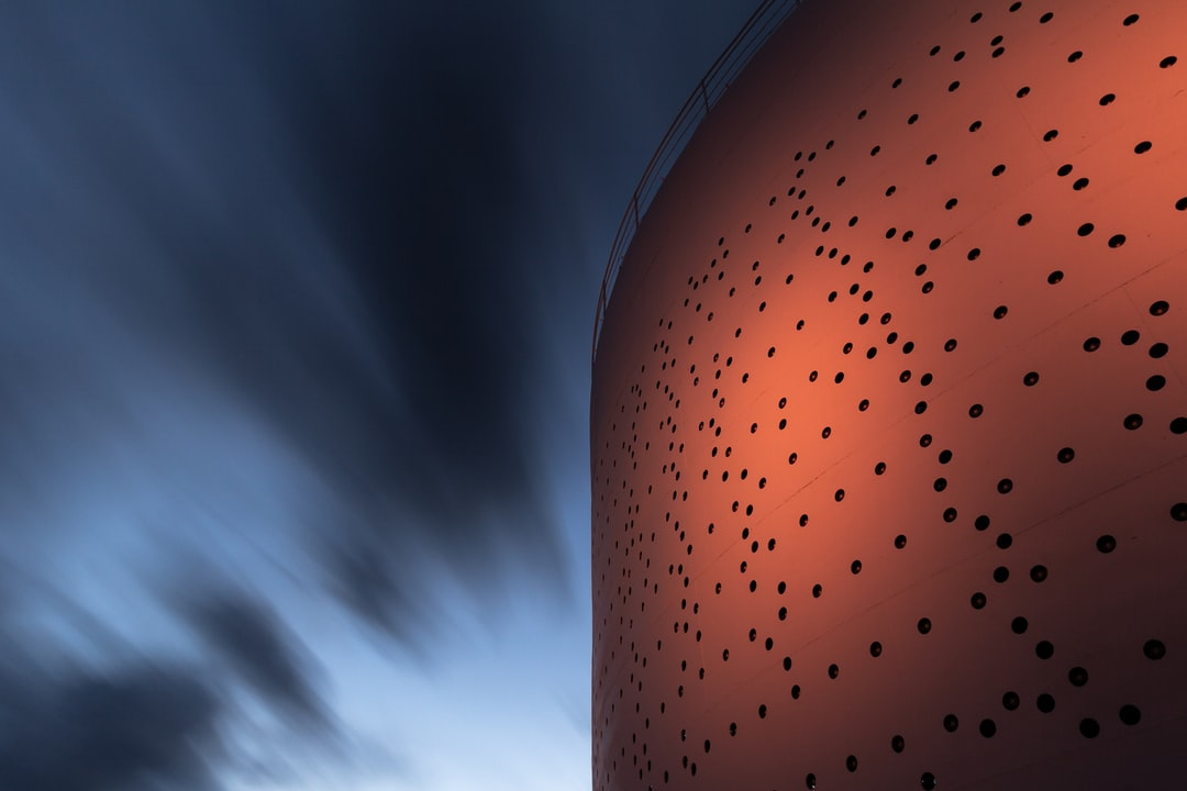 Oil Silo 468 in Helsinki, also known as 'Shining Beacon of Light', has been turned into a light artwork. A total of 2012 openings were cut into the shell of the silo and fitted with mirrors that reflect the sun. As night falls, LED lights turn the silo into a continuously changing light artwork. This shot was taken with a long 2-minute exposure.