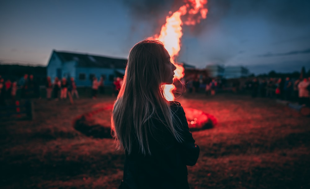 woman standing near fire