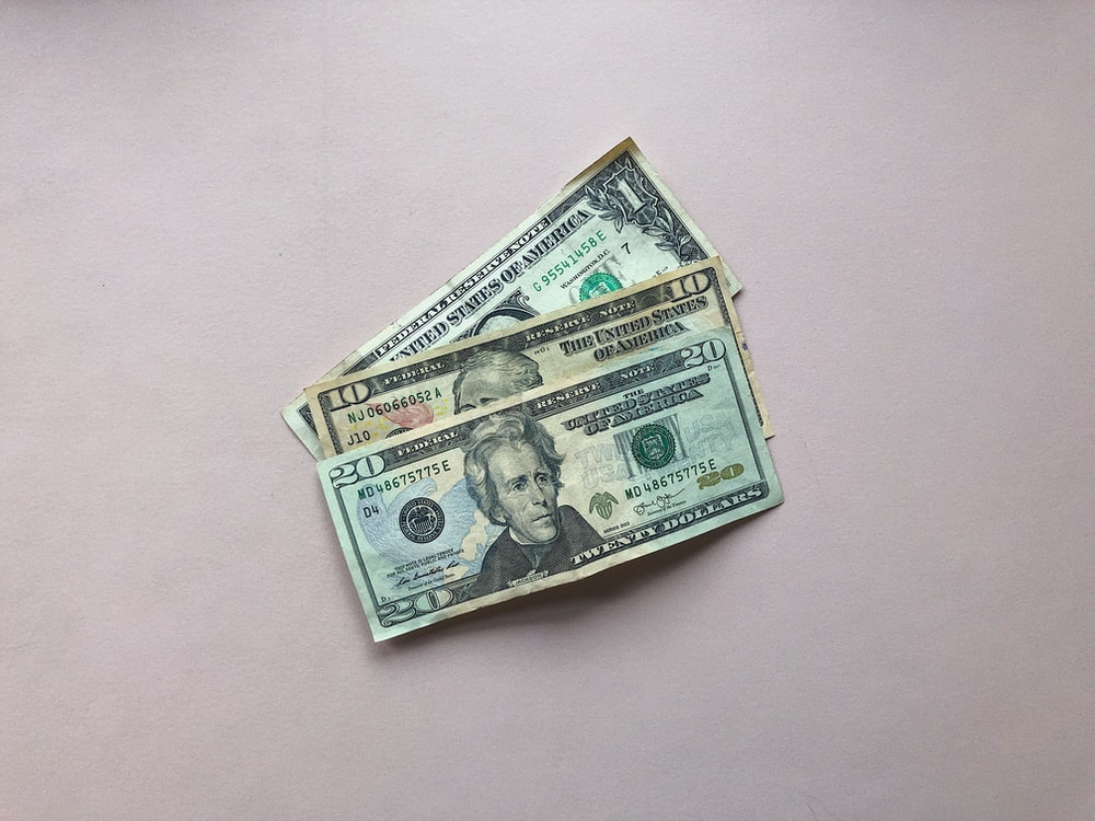 three assorted-denomination U.S. dollar banknotes