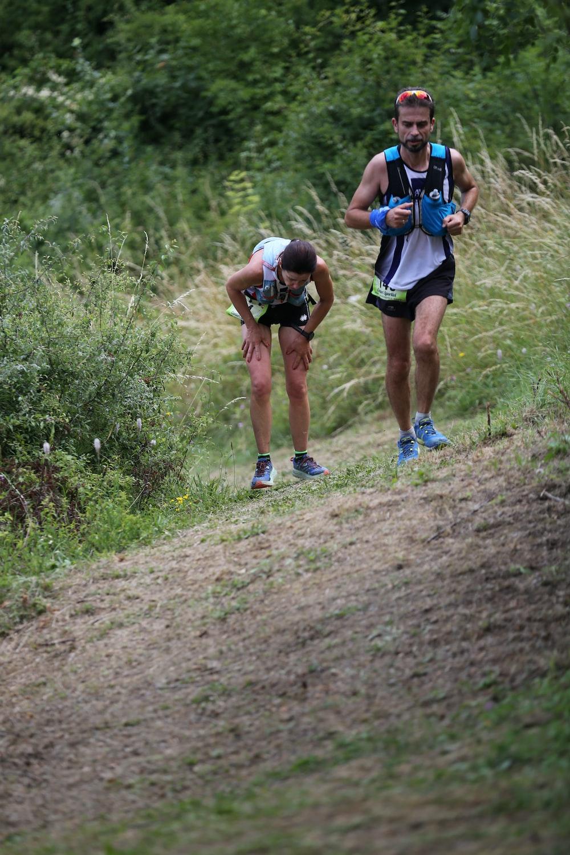 two men running on hill
