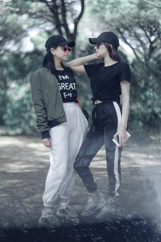 two women standing near trees