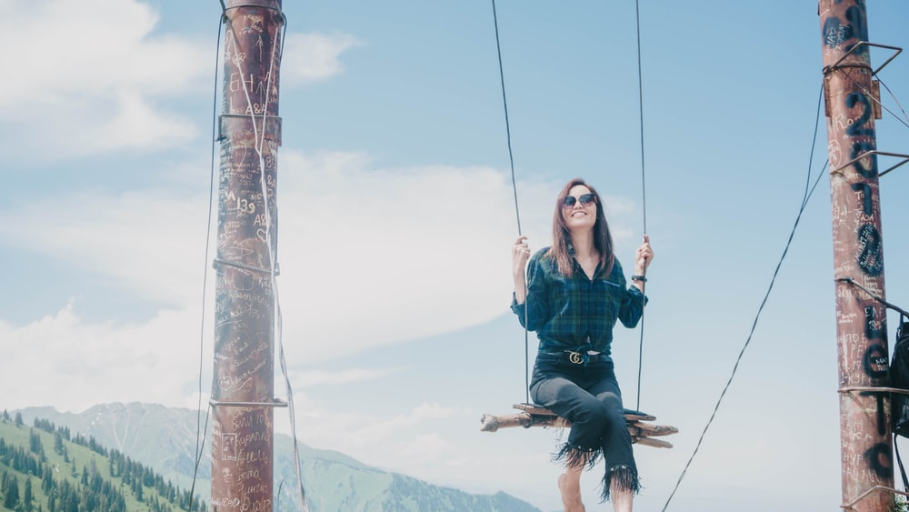 woman riding on swing