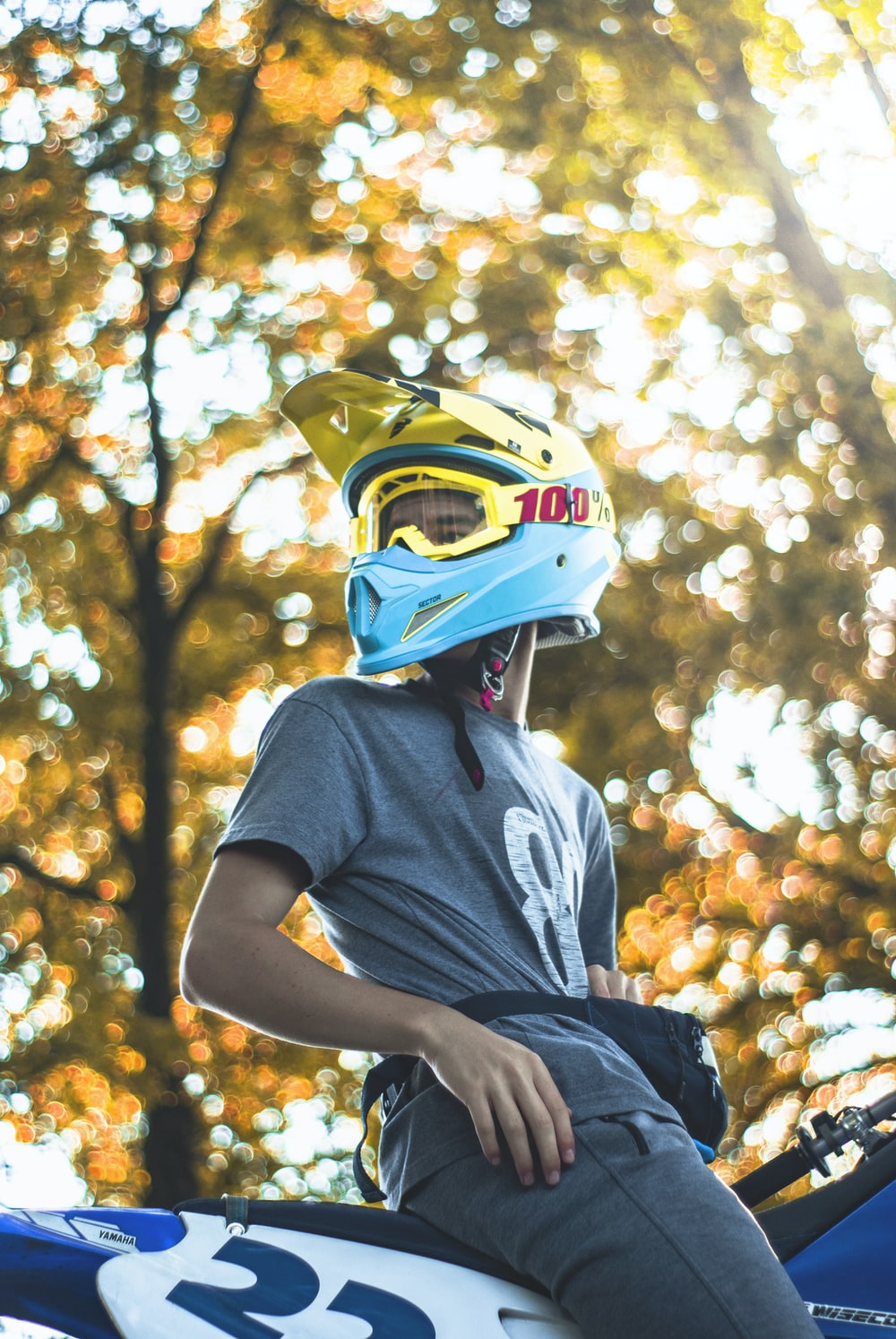 man wearing teal helmet