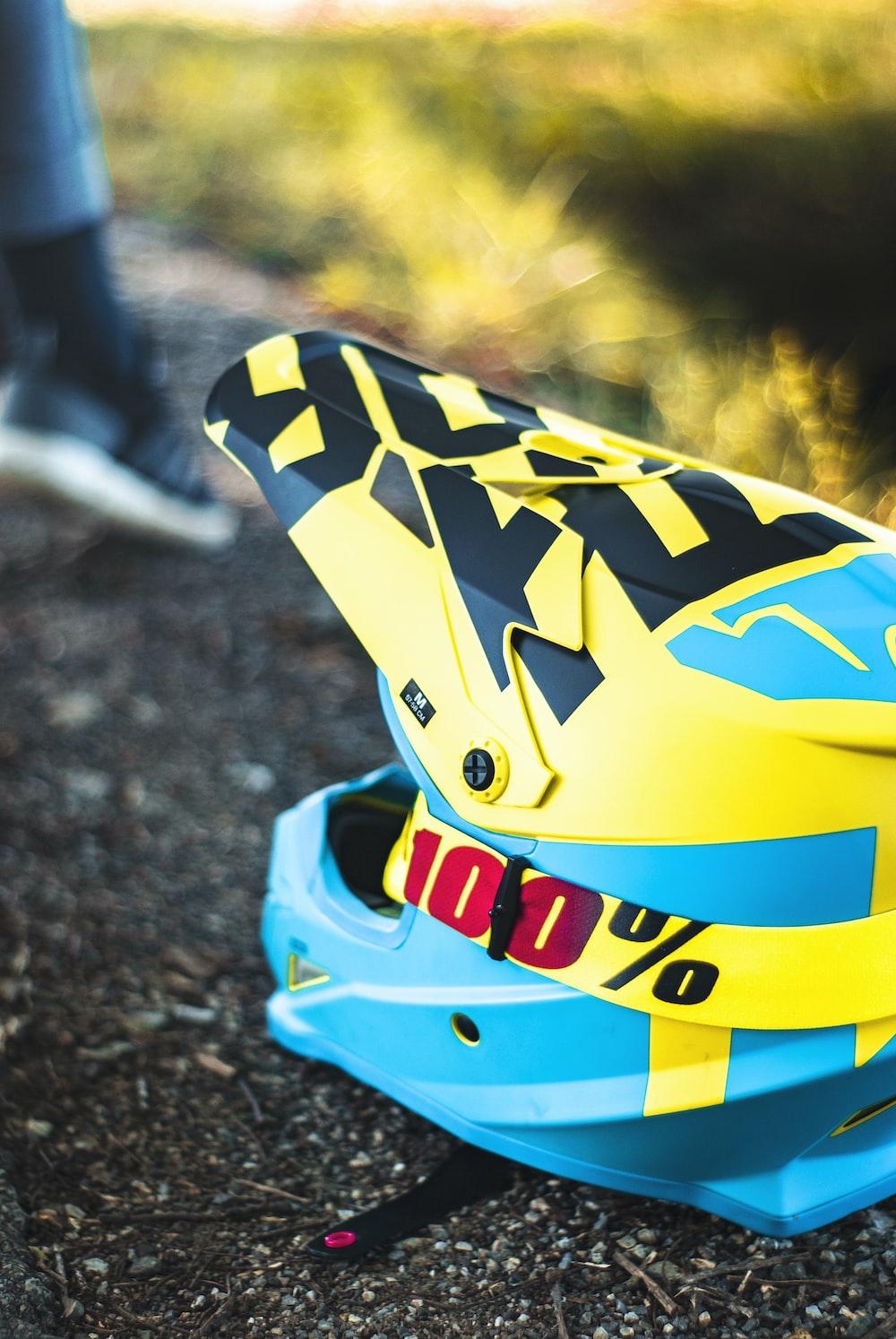 blue, yellow, and black motocross helmet