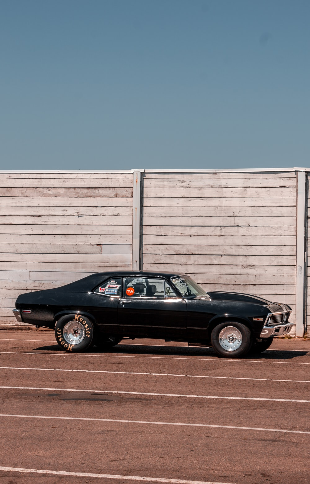 black coupe near wall
