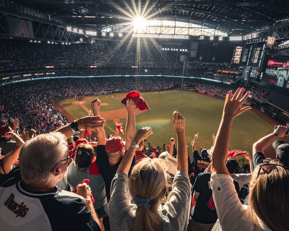 people watching baseball