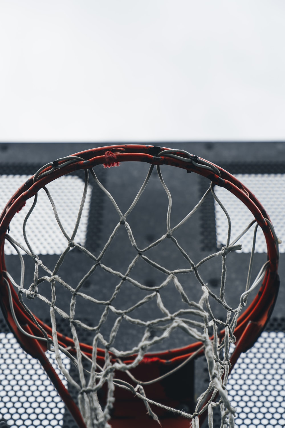 selective focus photography of red basketball ring
