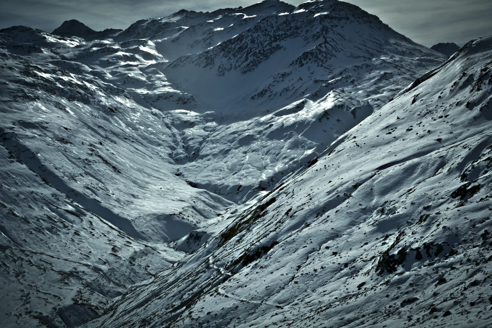 white snow covering mountain slope