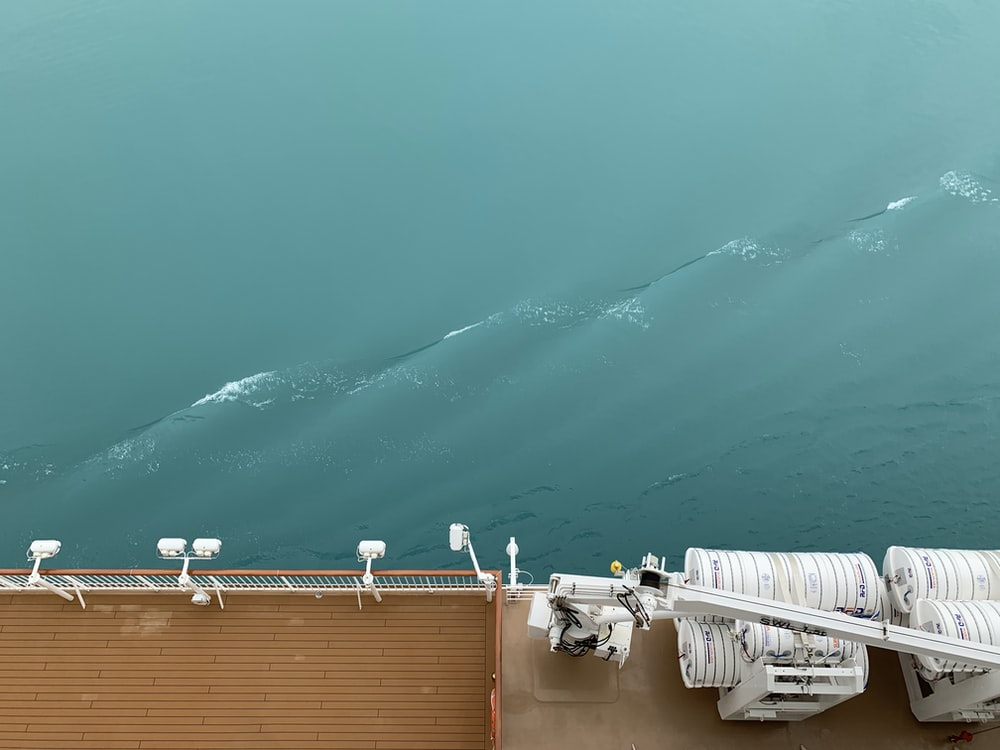 brown ship sailing on calm sea