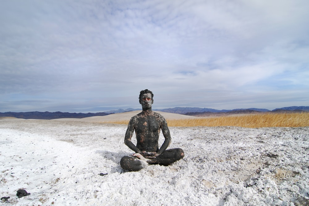 man sitting on shore