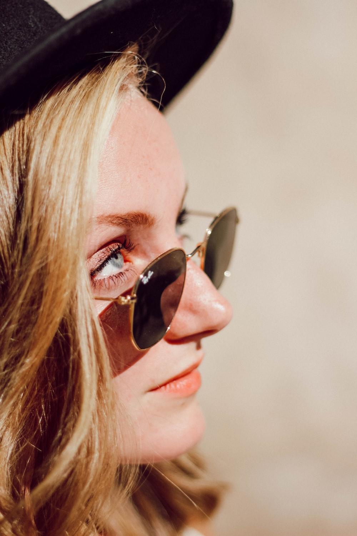 woman in black Ray-Ban sunglasses
