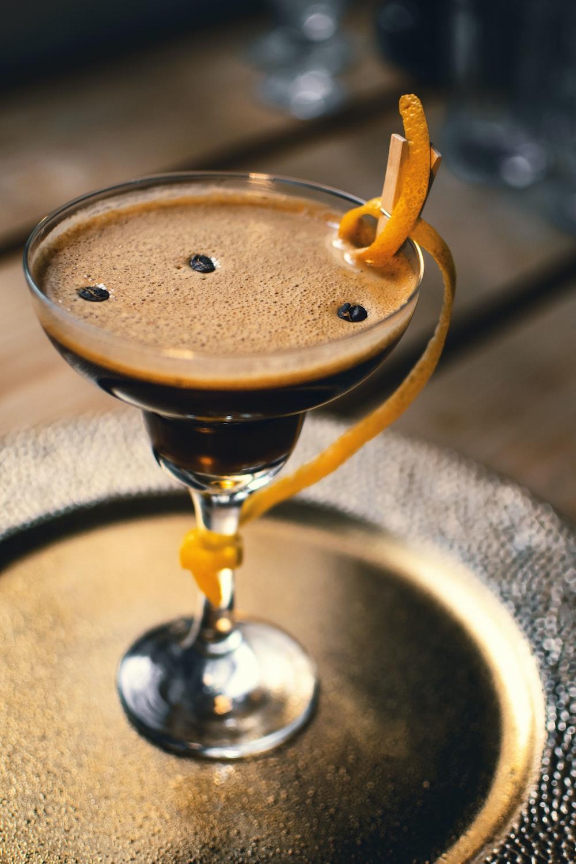 clear margarita glass with brown liquid