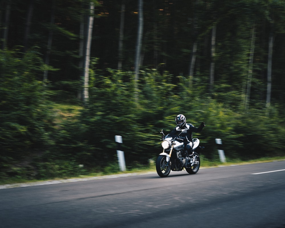 person riding on black motorcycles
