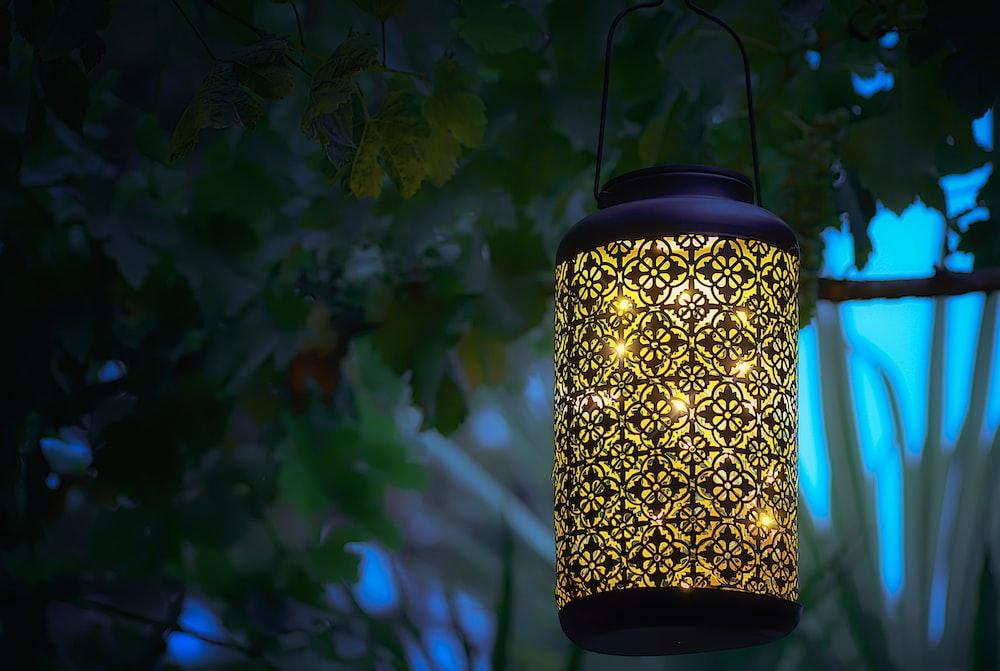 yellow metal hanging lantern