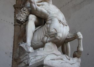 man fighting centaur statue
