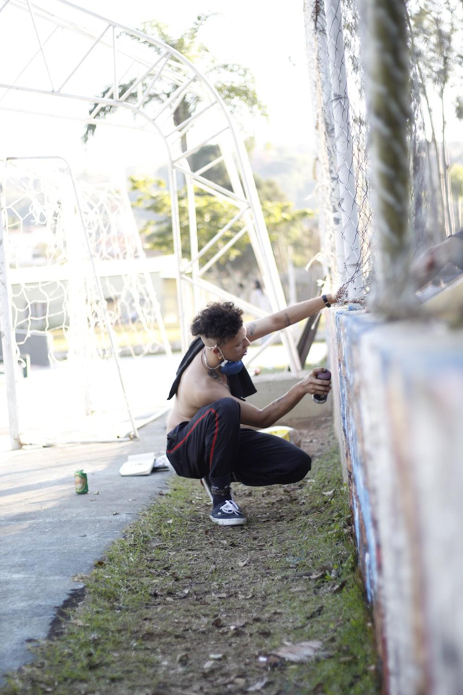 man bundling wall