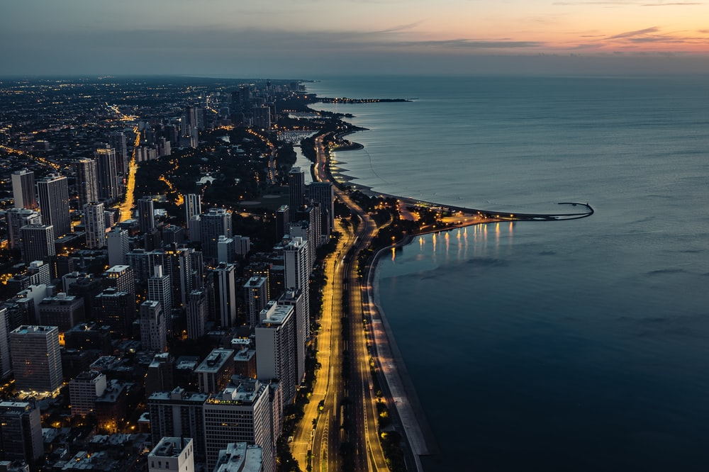 city and ocean during golden hour