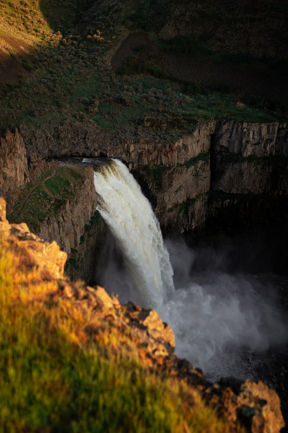 time-lapse photography of flowing plunge waterfall