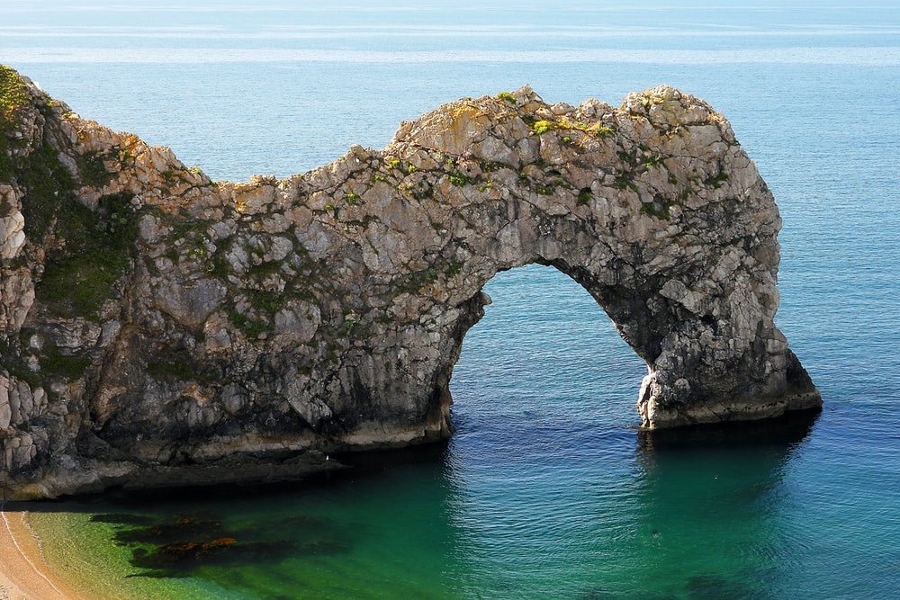 grey cliff on ocean