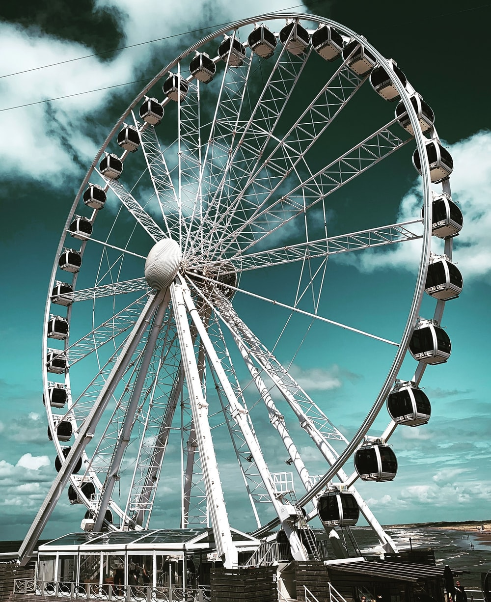 low angle photo of white and black Ferries wheel during daytime