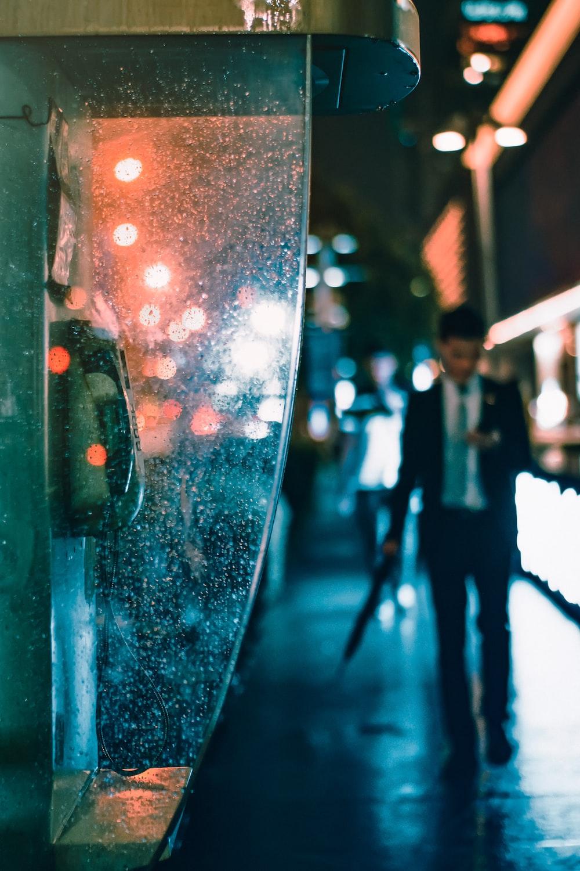 man walking near telephone