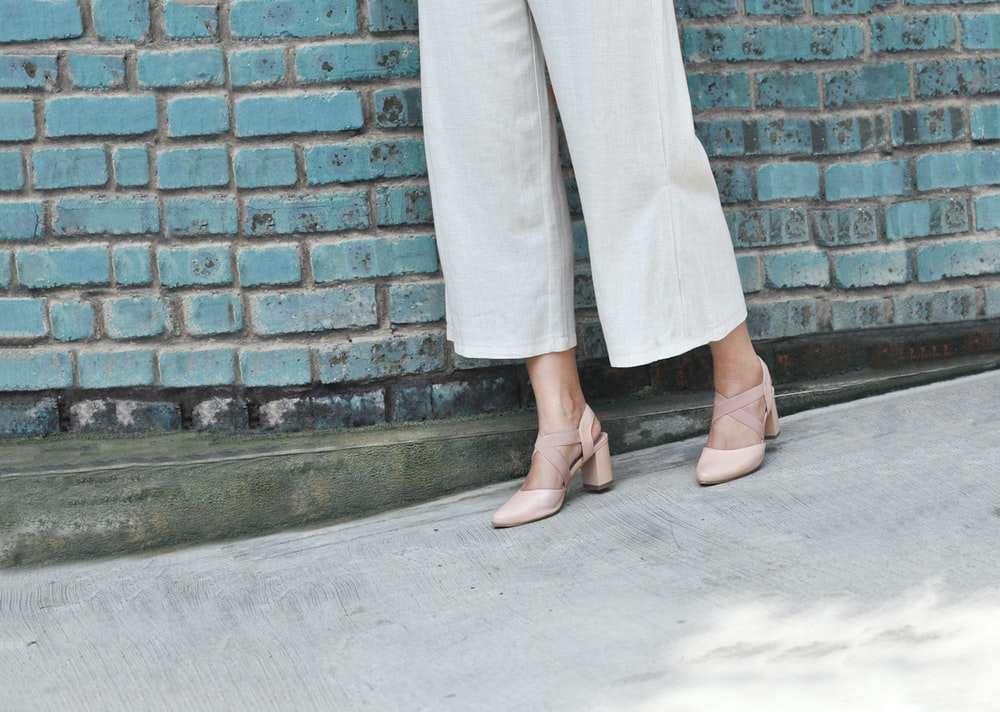 woman wearing gray pants and brown sandals