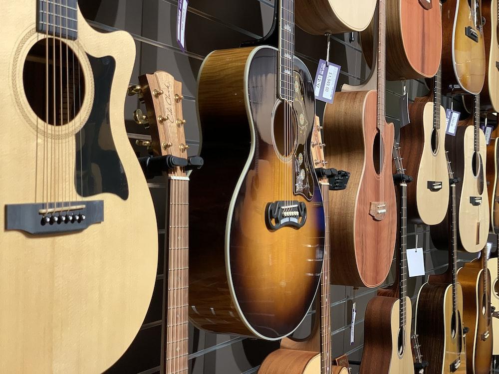 closeup photo of hanged guitars