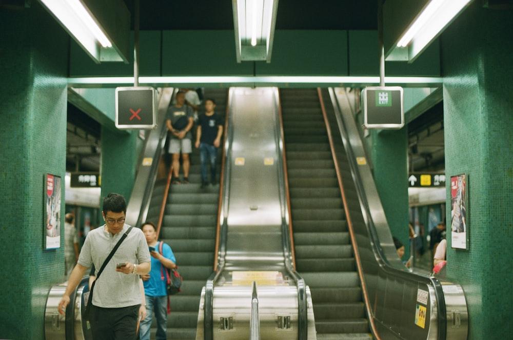 people near escalator