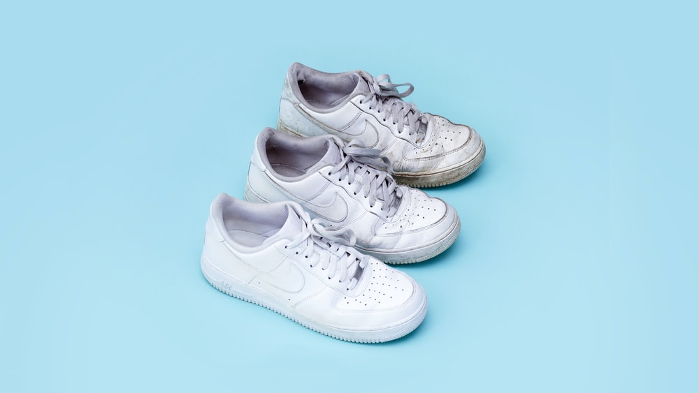 three white sneakers