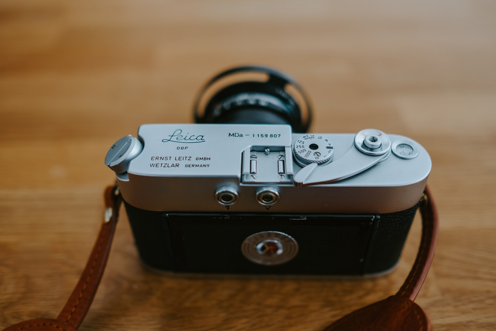 black and gray camera on brown surface