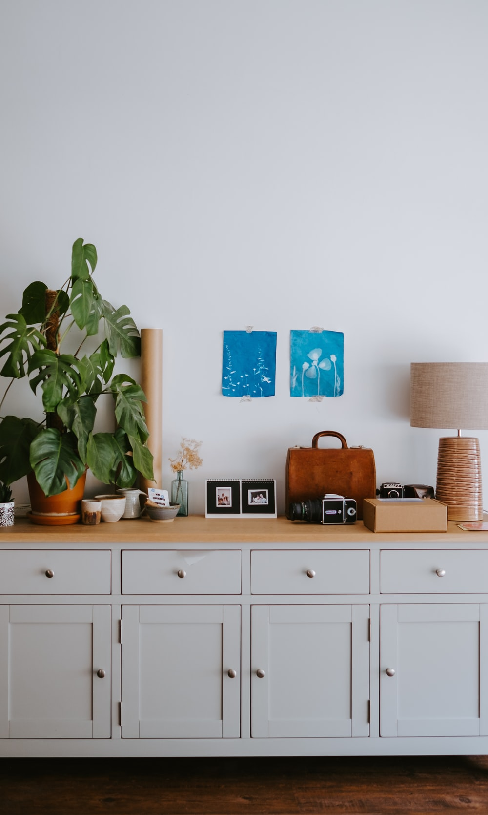 brown table lamp near green plants
